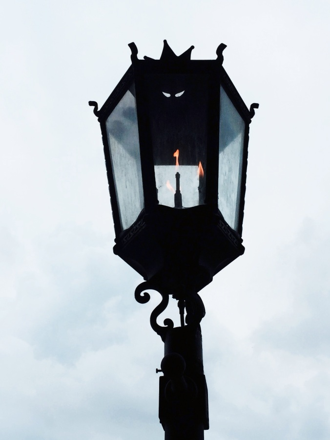 Gas lit street lamp.